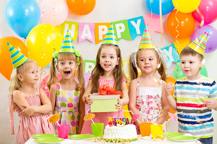 smiling kids or children on birthday party